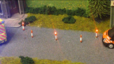 Roadwork cones with flashing orange lights